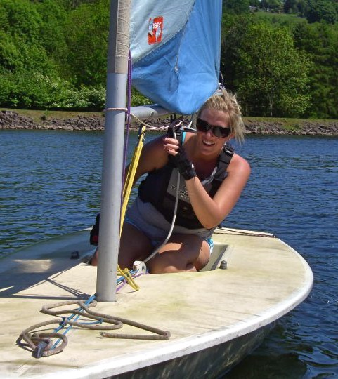 A young women learning to sail a Laser dinghy at Trimpley Sailing Club