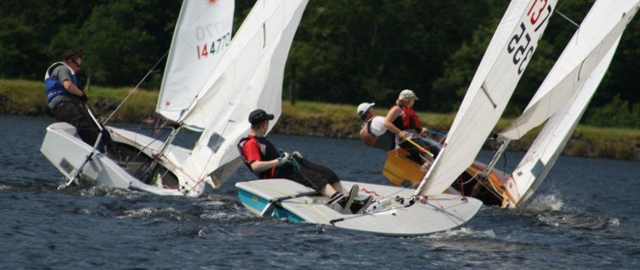 Lasers and GP14s race together in a menagerie race