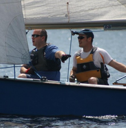 A crew gives directions to a new helm