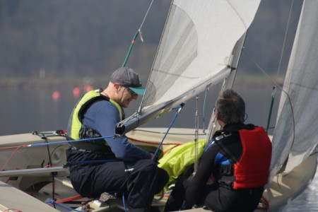 The crew of a GP14 heel the boat in light winds