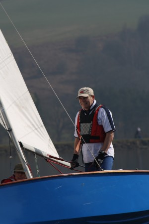 A man sails a GP14 heeled over in very light winds